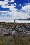 A man standing alone on the shore. Royalty Free Stock Photos