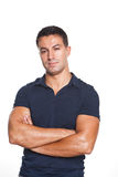 Man standing with armns crossed Stock Photo