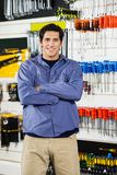 Man Standing Arms Crossed In Hardware Shop Stock Images