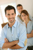 Man standing with arms crossed in office Royalty Free Stock Photography
