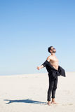 A man is standing with arms outstretched torso the sun royalty free stock image