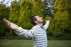 Man standing with arms wide open Stock Images