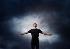 Man standing with arms wide open Stock Photography