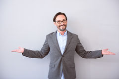 Man standing with arms wide open Royalty Free Stock Photography