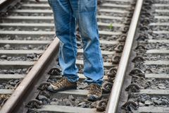 Young man is standing in a railway tracks stock photo royalty free stock image
