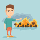 Man standing on the background of wildfire. Royalty Free Stock Photos