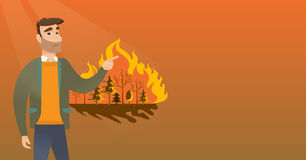 Man standing on the background of wildfire. Stock Images