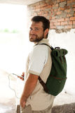 Man standing with backpack on his back Stock Images