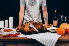 Man standing with baked turkey Stock Photos