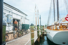 Man standing bare backed in doorway of wharf shed with walkway a Royalty Free Stock Photo