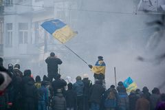 Man standing on barricades and waving flag in opposition to riot. Ukrainian people fight for freedom in kiev stock images
