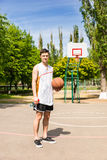 Man Standing on Basketball Court Holding Ball Royalty Free Stock Image