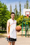 Man Standing on Basketball Court Holding Ball Stock Images
