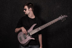 Man standing with bass guitar Royalty Free Stock Images