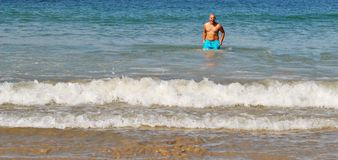 Man standing on the beach royalty free stock photos