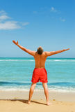 Man standing on the beach Royalty Free Stock Images