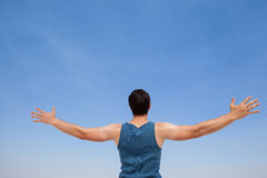 Man standing at beach with arms outstretched Royalty Free Stock Images