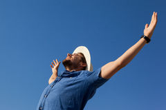 Man standing at beach with arms outstretched Royalty Free Stock Photo
