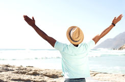 Man standing at beach with his hands wide open Royalty Free Stock Images