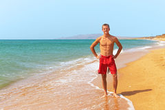 Man standing on the beach Royalty Free Stock Photography