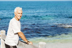 Man standing on beach in sports wear Royalty Free Stock Images