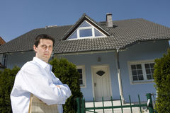 Man Standing Before The House Stock Photography