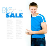 Man standing behind blank billboard Royalty Free Stock Images