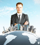 Man standing behind globe with city Stock Image