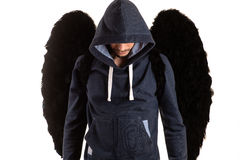 Man standing and black wings on his back Stock Photo