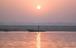 Man standing at the Boat. Sunset at the Holy river of Ganga in Varanasi, Uttar Pradesh, India Stock Photos
