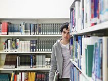 Man Standing By The Book Shelf Royalty Free Stock Images