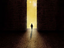Man standing on the border of darkness and light. Out of the darkness. Way from darkness to light Stock Photos