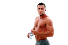 Man standing with bottle of water Royalty Free Stock Photography