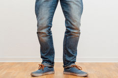 Man standing with bow legs Stock Photo