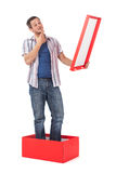 Man standing in a box Stock Photo