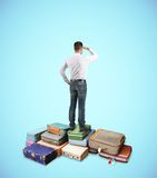 Man standing on briefcase Stock Images