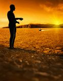 Man  standing  at bright sunset background Stock Image