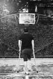 Man standing with broken leg in Plaster cast using Crutches at b Royalty Free Stock Photos