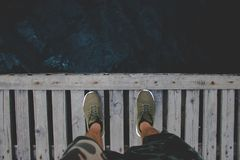 Man Standing on Brown Wooden Dock royalty free stock photography