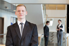 Man standing in business centre Stock Image