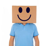Man standing with a cardboard box on his head with smiley face Stock Photos