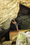 Man standing in a cave Stock Images