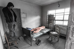 Man standing chair old room poor abandoned, frustration b&w emotion. Man standing chair inside old poor abandoned room, monochrome dull colors, feeling royalty free stock photos