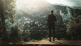 Man Standing On Cliff Stock Images