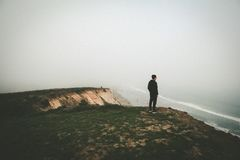 Man standing on cliff Stock Photography
