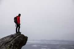 Man Standing on a Cliff Next to Sea Royalty Free Stock Photography
