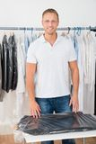 Man standing in clothing store Royalty Free Stock Photos