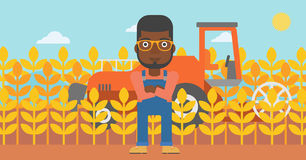 Man standing with combine on background. Royalty Free Stock Image