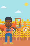 Man standing with combine on background. Royalty Free Stock Images