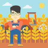 Man standing with combine on background. An asian farmer standing on the background of combine harvesting wheat. Young farmer working on a wheat field. Vector Stock Photo